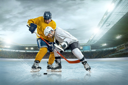 Ice hockey player on the ice  Open stadium - Winter Classic game Stock Photo - 26945446