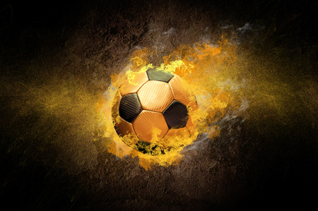 Hot soccer ball on the speed in fires flame, grunge background