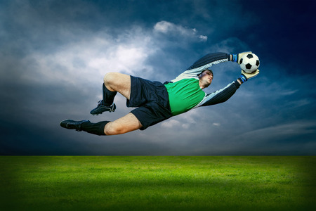 Football player with ball in action outdoors photo
