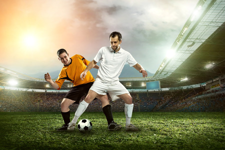 player: Soccer player with ball in action outdoors. Stock Photo