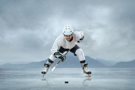 Ice hockey players on the ice photo