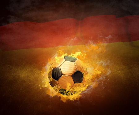 scorching: Hot soccer ball in fires flame on the national flag background