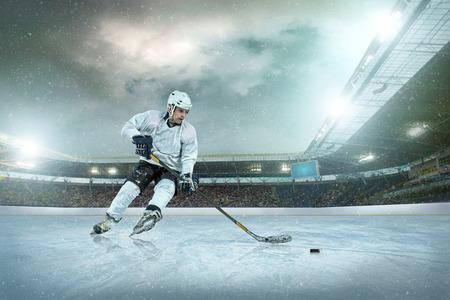 hockey ice: Ice hockey player on the ice. Open stadium - Winter Classic game.