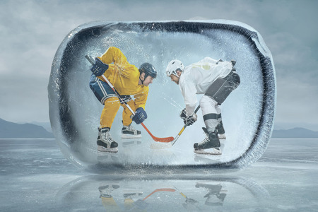 Ice hockey players in the ice photo