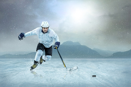 Ice hockey player on the ice, outdoor  photo