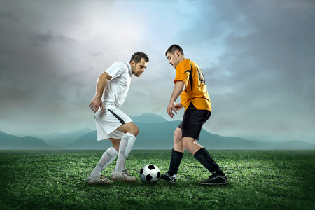 Soccer player with ball in action outdoors  photo