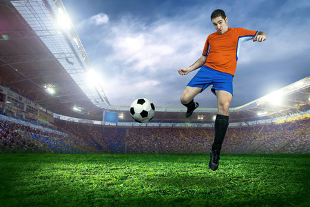 Football player in action on field of stadium photo