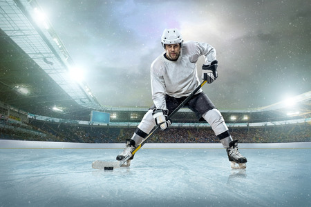 hockey puck: Ice hockey player on the ice  Open stadium - Winter Classic game