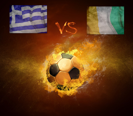 scorching: Hot soccer ball in fires flame, friendly game beetwin Greece and Cote de voire Stock Photo