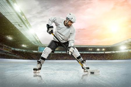 Ice hockey player on the ice  Open stadium - Winter Classic game Stock Photo - 27486535