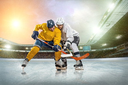 helmet seat: Ice hockey player on the ice. Open stadium - Winter Classic game.