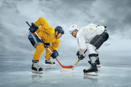 hockey puck: Ice hockey players on the ice Stock Photo