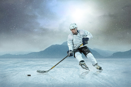 Ice hockey player on the ice, outdoor. photo