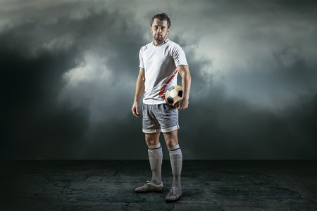 soccer boots: Soccer player with ball, outdoors