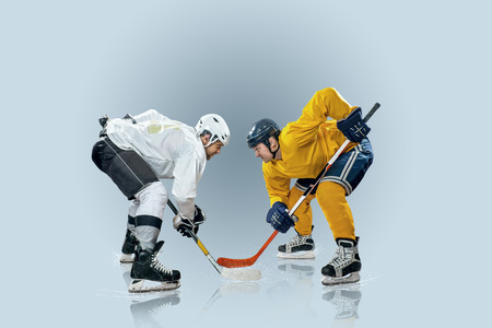 Ice hockey player on the ice and light effects photo