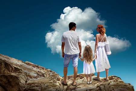 stay beautiful: Family stay on the top of mountain, looking on the beautiful view. Stock Photo