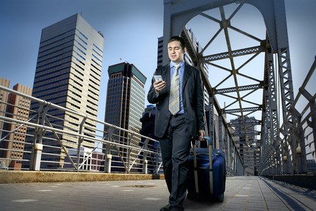 Man with baggage speaking by phone on the bridge Stock Photo - 30155511