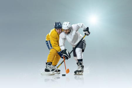 hockey player: Ice hockey player on the ice and light effects