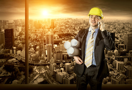 Architect in protective helmet speaking by phone Stock Photo - 30202764