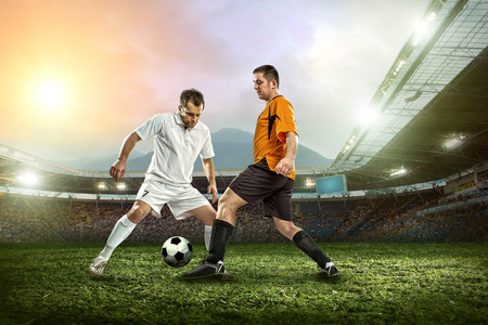 Soccer player with ball in action outdoors. Stock Photo - 30202833