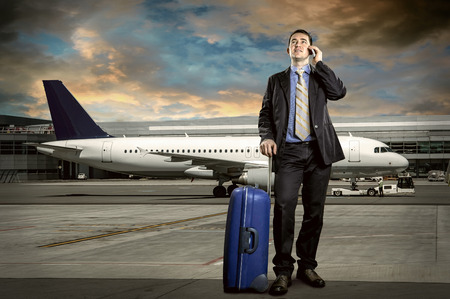 business lounge: Businessman with baggage in airport Stock Photo