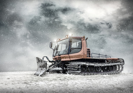 Tractor cleaning snow outdoors photo