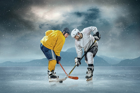 Ice hockey player on the ice photo