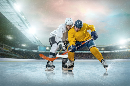 hockey puck: Ice hockey player on the ice. Open stadium - Winter Classic game.