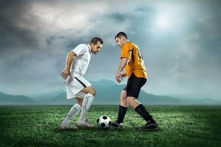 Soccer player with ball in action outdoors. photo