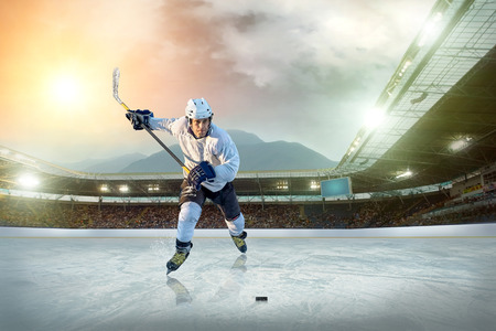 rink: Ice hockey player on the ice. Open stadium - Winter Classic game.