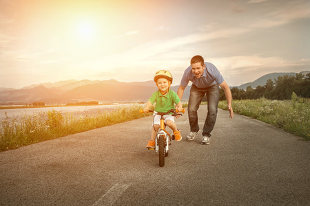 Happiness Father and son on the bicycle outdoor photo