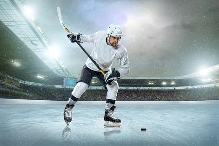ice hockey player: Ice hockey player on the ice. Open stadium - Winter Classic game.