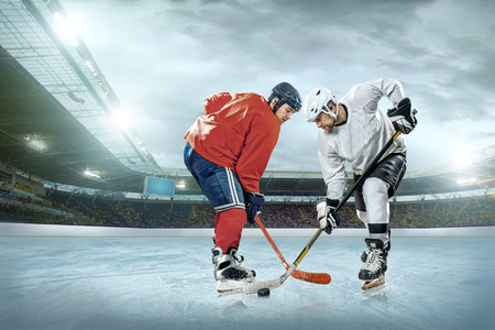 iceskating: Ice hockey player on the ice. Open stadium - Winter Classic game.