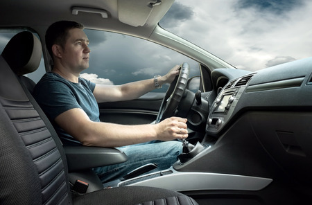 Man sitting and driving in the car photo