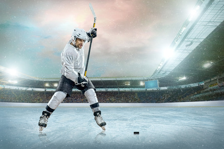 ice cold: Ice hockey player on the ice. Open stadium - Winter Classic game.