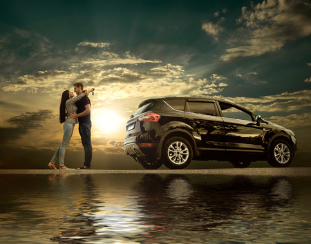Happiness couple stay near the new car under sky with reflex photo