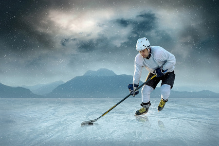ice cold: Ice hockey player on the ice. USA national team. Stock Photo