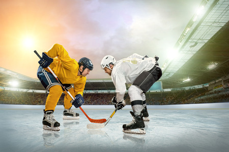 hockey skates: Ice hockey player on the ice. Open stadium - Winter Classic game.