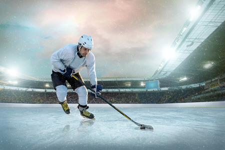 sportsmanship: Ice hockey player on the ice. Open stadium - Winter Classic game.