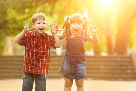 healthy sport: Happiness boy and girl fun outdoor under sunlight Stock Photo