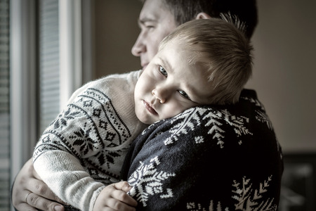 son: Father and son.Indoor near the window.