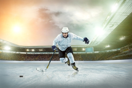 Ice hockey player on the ice. Open stadium - Winter Classic game. photo