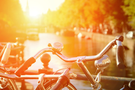 people travelling: Amsterdam view with bicycles under sun light