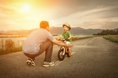 riding helmet: Father and son on the bicycle outdoor