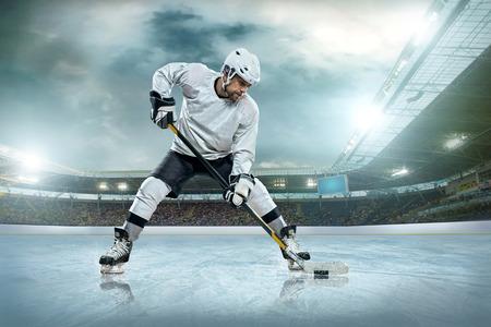 hockey games: Ice hockey player on the ice. Open stadium - Winter Classic game.