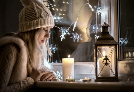 smile christmas decorations: Woman in white hat in eve Christmas and New Year