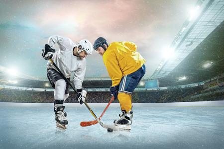 hockey: Ice hockey player on the ice. Open stadium - Winter Classic game.