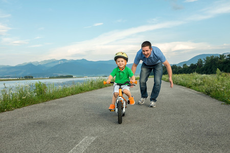 road bike: Happiness Father and son on the bicycle outdoor