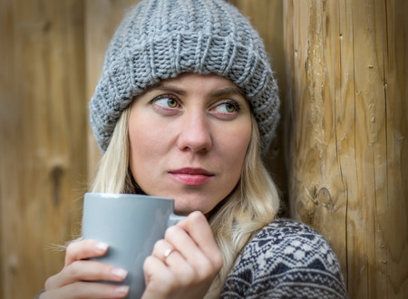 cold weather: Beautiful blonde female drink coffee uoutdoor