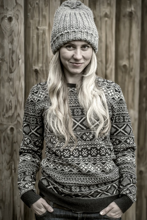 stay beautiful: Beautiful blonde female stay uoutdoor on the wood background